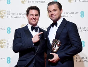 Leonardo DiCaprio with the award for a leading actor for his work on the film 'The Revenant' with Tom Cruise who presented the award