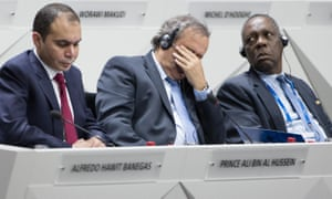 UEFA president Michel Platini, center, has the demeanour of a manager whose side has taken a hiding. Next to him is FIFA vice president Jordanian Prince Ali bin al Hussein, left, and Challenger to Joseph S. Blatter for the FIFA presidency,Issa Hayatou.