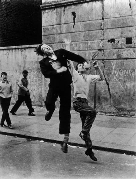 'Jumping for joy': Street Football (1958) shows boys on Mayne's beloved Southam Street.