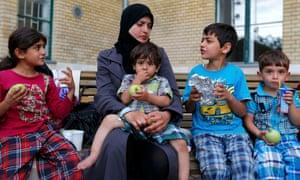 Asylum seekers await transport