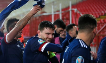 Andy Robertson celebrates with his Scotland teammates after victory in Belgrade.