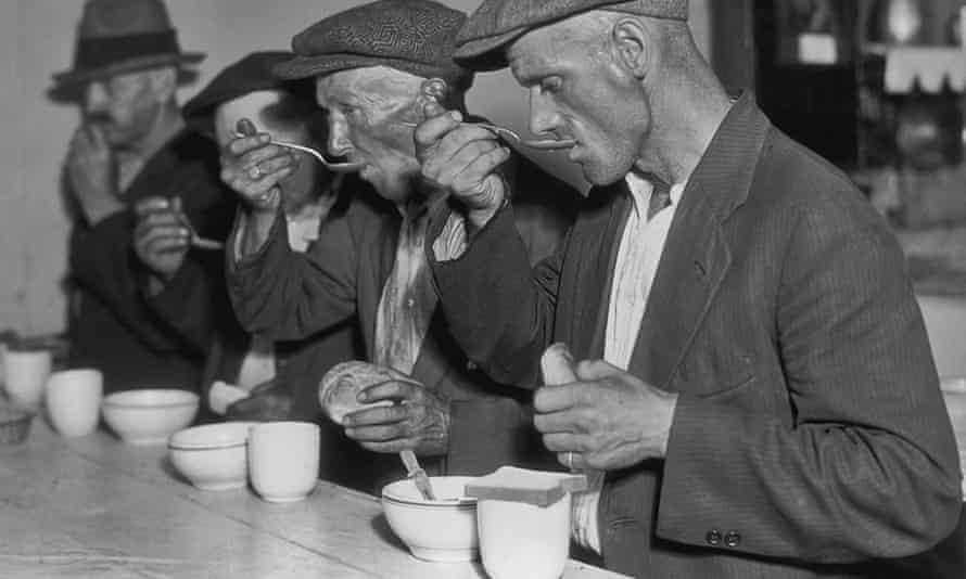 Unemployed men eat soup in Washington, circa 1935.