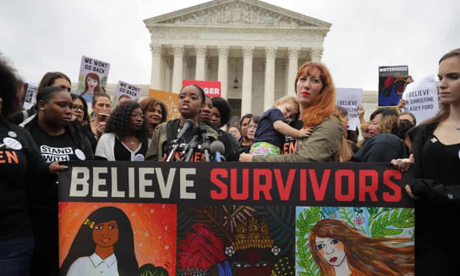 The Women's March leaders Tamika Mallory, at the microphones, Bob Bland, second right, address a rally against the confirmation of Brett Kavanaugh for the supreme court.
