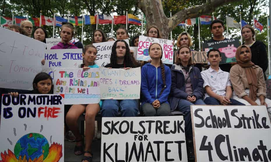 Greta Thunberg, center, joins activist outside the United Nations during a protest against climate change on 6 September in New York.
