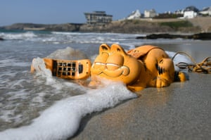 A plastic Garfield phone washed up on the beach in Le Conquet, France