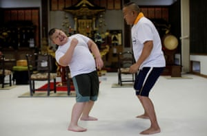 Kumagai practices with his father, Taisuke, during a one-on-one training session at the Buddhist temple Joshin-ji in Tokyo