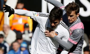 Valencia's Andre Gomes in action against Diego Llorente, of Rayo Vallecano, during their La Liga match at the Mestalla.