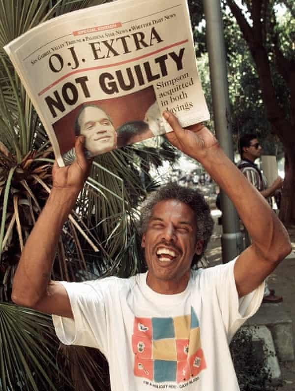 A man celebrates OJ Simpson's acquittal in 1995