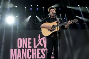 Marcus Mumford performs on stage during the One Love Manchester Benefit Concert