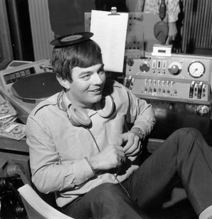 Tony Blackburn balances a single on his head at the opening of BBC Radio 1 in 1967.