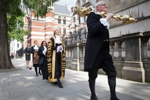 Liz Truss walks into the Royal Courts of Justice before being installed as lord chancellor.