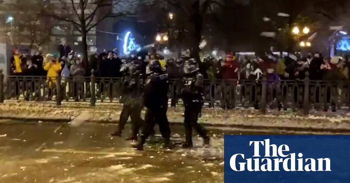 Russia protests: police pelted with snowballs in Moscow – video