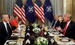 Donald Trump chats to Nato's Jens Stoltenberg at the breakfast meeting
