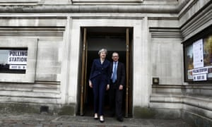 May and her husband Philip leave after voting in local government elections in London