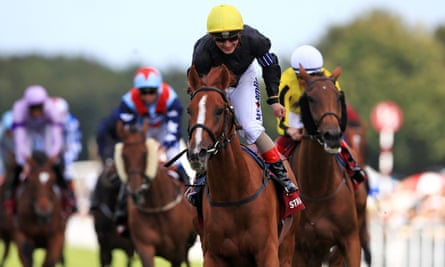 Andrea Atzeni celebrates winning his third race of the day on Stradivarius in the Goodwood Cup with Big Orange, right, in second.