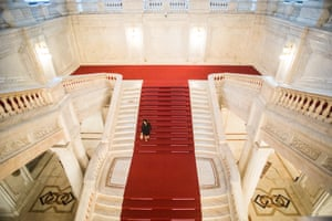 A woman walks down some stairs inside the Romanian Parliament, in Bucharest.