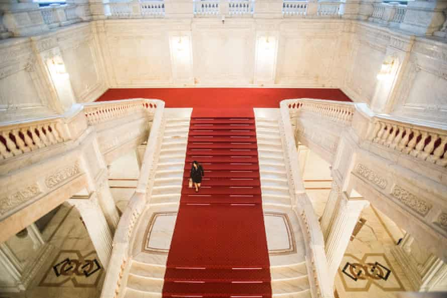 A woman walks down stairs inside the Romanian parliament in Bucharest