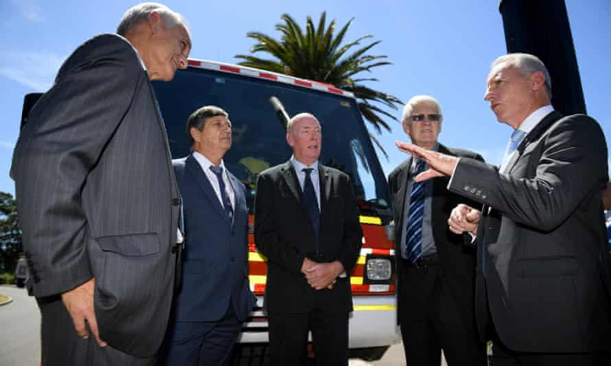 """Former emergency services chiefs – (from left): Bob Conroy, Lee Johnson, Mike Brown, Neil Bibby and Greg Mullins – say the government """"fundamentally doesn't like talking about climate change""""."""