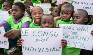 "Congolese children hold a placard that reads ""the Congo is indivisible"" during a global rally ""One Billion Rising"", which is part of a V-Day event calling for an end to gender-based violence, in Bukavu February 14, 2013."