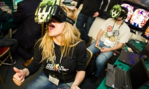 A woman playing VR at the GameCity festival
