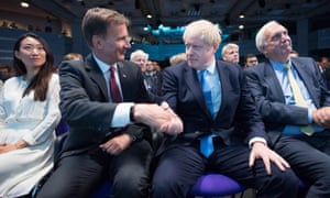 Boris Johnson and Jeremy Hunt shake hands after the result is announced.
