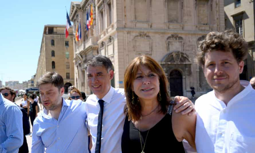 Michèle Rubirola, who has been elected mayor of Marseille, stands with other mayoral candidates of leftwing alliance 'Printemps Marseillais' in front of the city hall