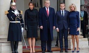 A military guard stands alongside Melania and Donald Trump and Emmanuel and Brigitte Macron.