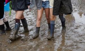 girls walking in the mud