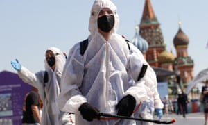 Workers disinfect a book fair at Red Square in Moscow.