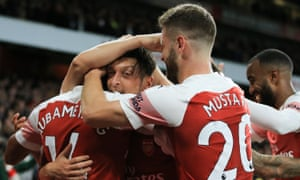 Arsenal players, among them Mesut Özil, celebrate during their 3-1 victory over Leicester City on Monday. Unai Emery's men have now won 10 successive games in all competitions