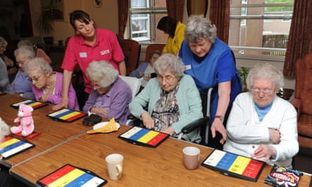 Residents play bingo in a care home