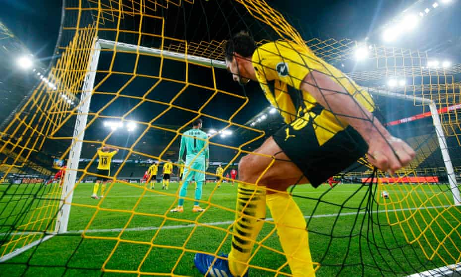Mats Hummels ends up in the net after desperately trying – and failing – to keep David Alaba's shot out.