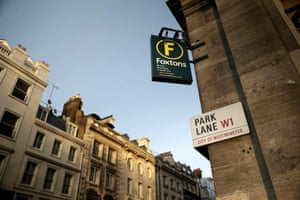 A Park Lane street sign sits on the wall of a Foxtons Ltd. estate agents in the Westminster district of in London.