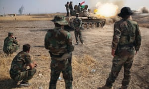 Kurdish Peshmerga soldiers unleashed heavy tank fire on Isis fighters along the Khazer river near the Iraqi city of Mosul.