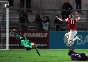 Vivienne Miedema scores Arsenal's second goal, looping her finish over Fiorentina's Francesca Durante