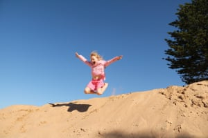 Jump for joyMy Grandaughter's reaction to finding a huge sand dune was to leap from it, free as a bird.