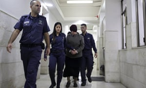 Malka Leifer, centre, is brought to a courtroom in Jerusalem.