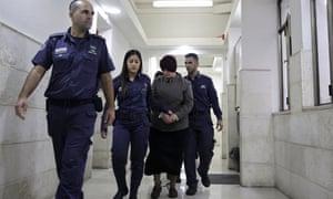 Malka Leifer being led to a courtroom in Jerusalem
