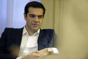 <br>Greece's Prime Minister Alexis Tsipras listens to Greek President Prokopis Pavlopoulos tonight.