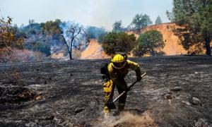 A firefighter attacks a hot spot.
