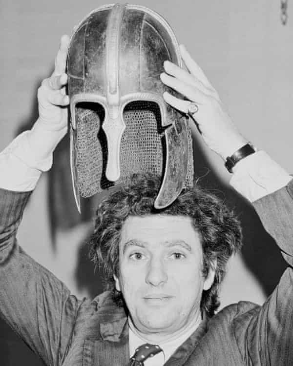 Lord Gowrie holding the Coppergate Helmet (York Helmet), an Anglo-Saxon helmet, above his head in London on 6 March 1984.