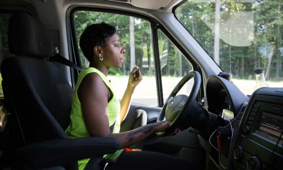 Kristal chews on sunflower seeds to keep her alert. On top of running the van company, she has a full-time job as a social worker.