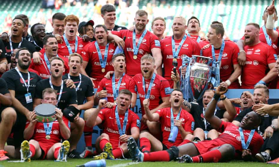 Saracens players lift the Premiership trophy following a thrilling victory over Exeter at Twickenham.