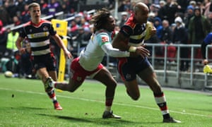 Tom Varndell goes over to score his record breaking try on Friday against Harlequins as he fends off Marland Yarde's tackle.