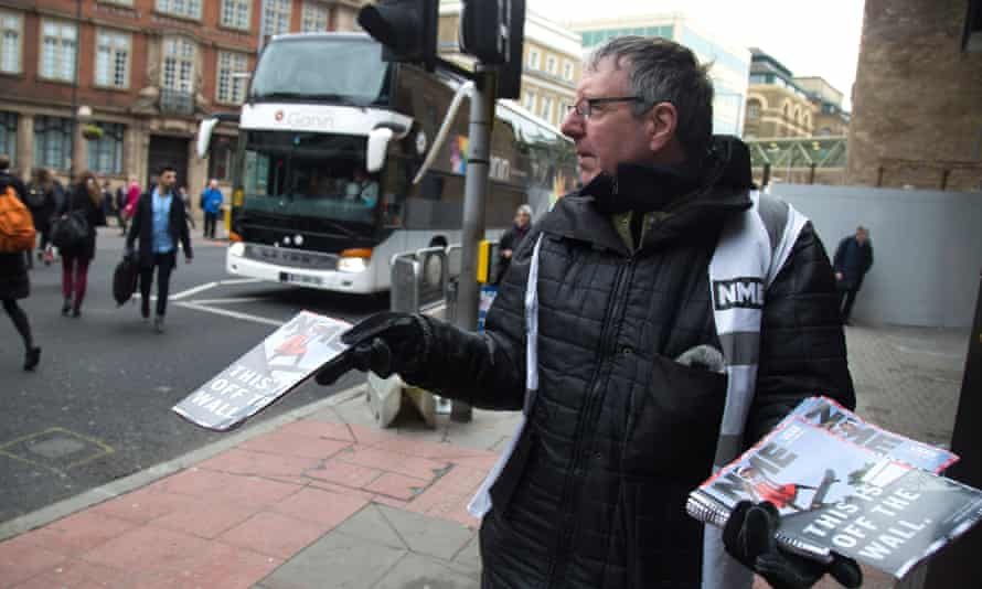A vendor hands out the final copy of NME at London Bridge, 9 March.