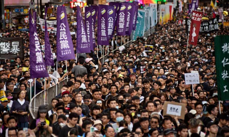 Thousands of protesters take part in a mass rally in Hong Kong, which China has blamed on 'foreign interference'.