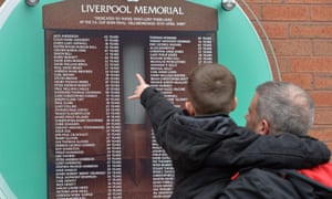 Mourners marking the 26th anniversary of the Hillsborough disaster at a memorial in Liverpool last month.