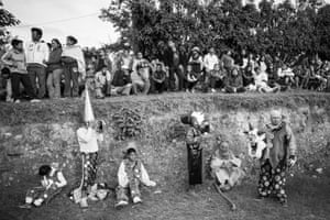 In the countryside surrounding Oaxaca, muerteadas ('walk with the dead') process through villages, stopping to dance, sing, drink and celebrate with the locals. Here, revellers pause for breath, beer or a cigarette before setting off for the next village.