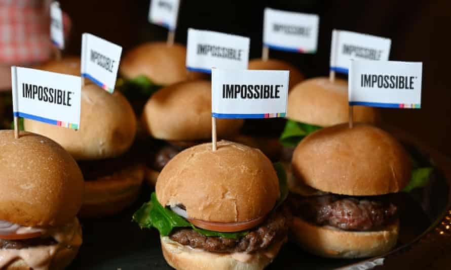 """US-LIFESTYLE-COMPUTERS-HEALTH-AUTOMOBILE<br>The Impossible Burger 2.0, the new and improved version of the company's plant-based vegan burger that tastes like real beef is introduced at a press event during CES 2019 in Las Vegas, Nevada on January 7, 2019. - The updated version can be cooked on a grill and has a better flavor and lowered cholesterol, fat and calories than the original. """"Unlike the cow, we get better at making meat every single day,"""" CEO of Impossible Foods CEO Pat Brown. (Photo by Robyn Beck / AFP)ROBYN BECK/AFP/Getty Images"""