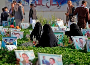 Yemenis visit the grave of loved ones in the capital, Sana'a